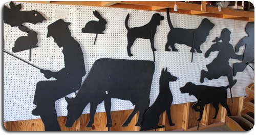silhouette of dogs, cow, easter rabbit, a man fishing, girl, boy, black bat, halloween