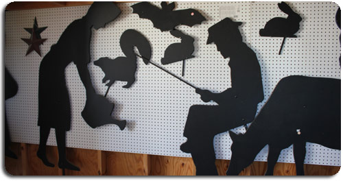 silhouettes man fishing, woman watering garden, skunk, bunnies, bats, stars, cow